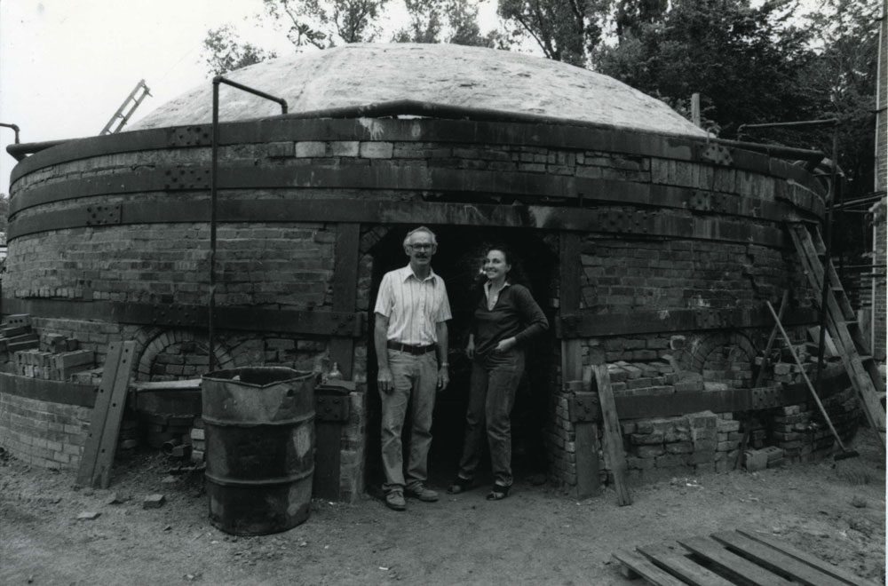 Ree Kaneko with Morrie Cullen, owner of the Omaha Brickworks, outside one of the Brickworks' massive industrial kilns in 1982. Photo courtesy Ree Kaneko.